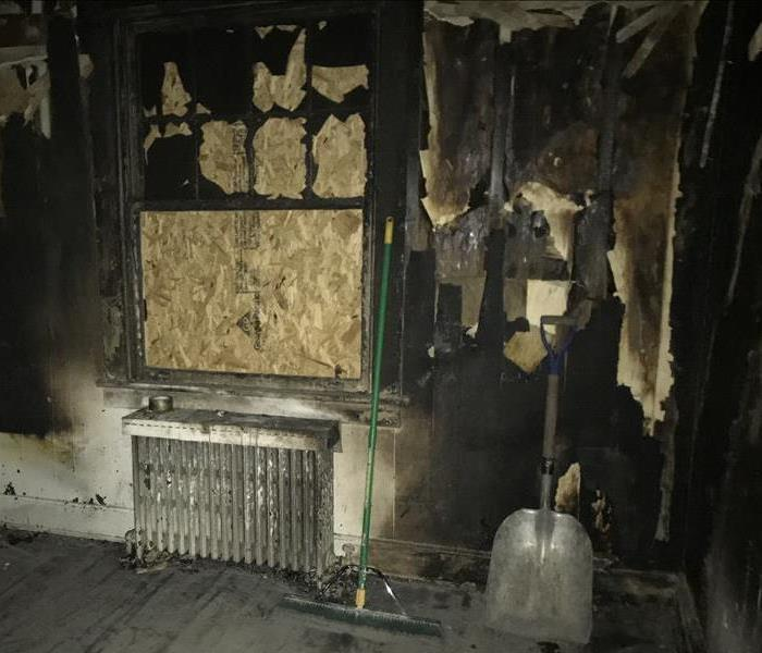 fire damage in bedroom - laptop caught on fire